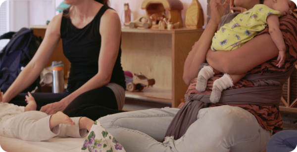Mother together with babies during support group meeting