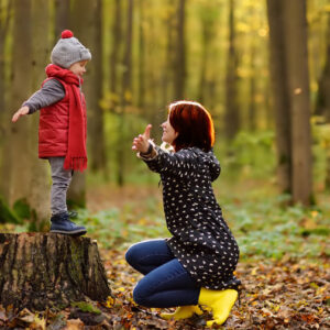 Mom with child in the woods