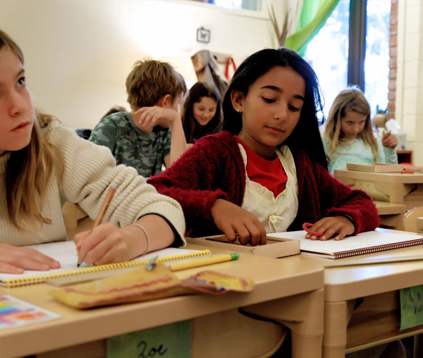 Children sitting at desks and working
