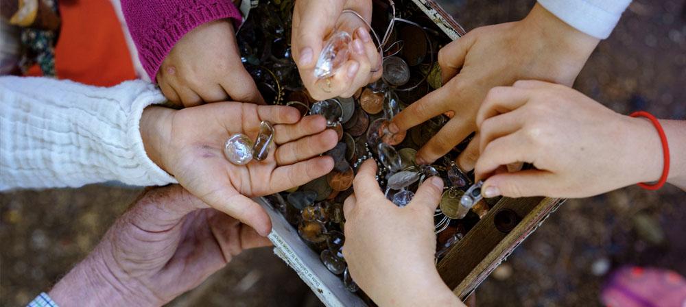 Children are given treasures by the Treasureman