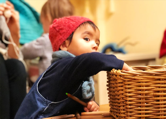 Child exploring contents in a basket